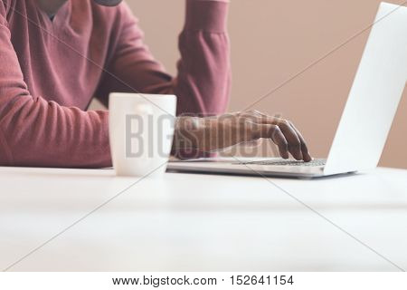 Black man Hands typing on laptop in office