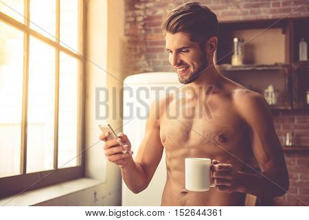 Sexy Young Man In Kitchen