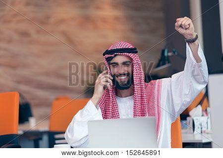 Arabian Businessman Working In Modern Startup Office