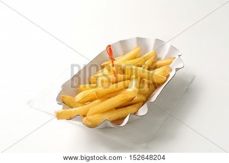 Fresh french fries in paper plate on white background