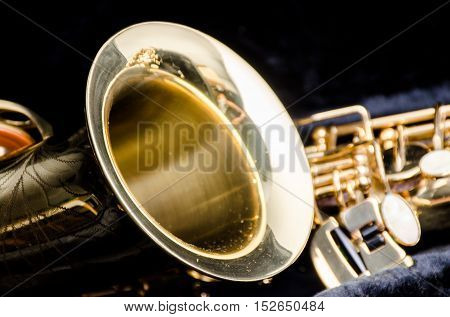 Saxophone alto jazz music instrument close up some light and shadow isolated on black