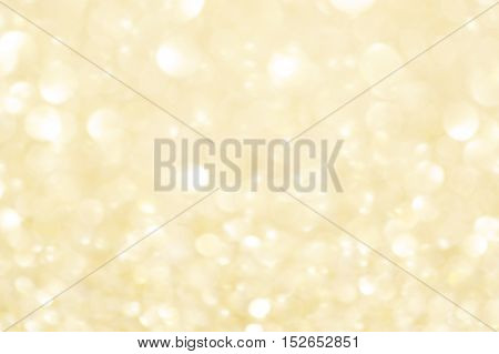 Festive blur background. Abstract twinkled Christmas background with bokeh defocused golden lights and stars.