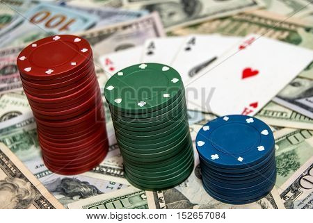 poker chips  with card on a background of dollars