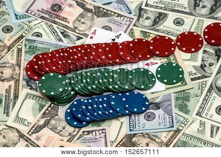 Many Usa dollar bills with poker chips