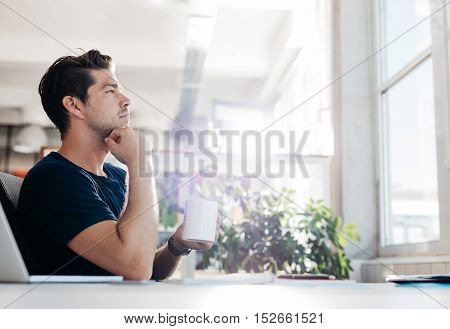 Businessman Sitting In Office And Thinking