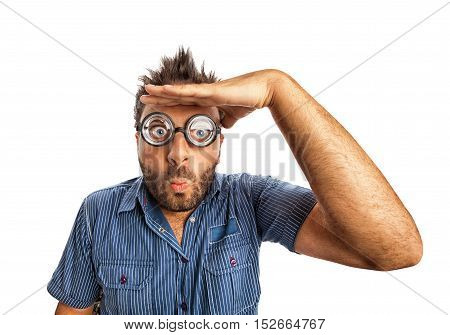 Man with funny expression and thick glasses looking far away on white background.