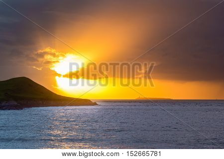 Sunset behind Flat Holm Island in the Bristol Channel. Spectacular sky and clouds seen from Sand Point north of Weston-super-Mare in Somerset UK