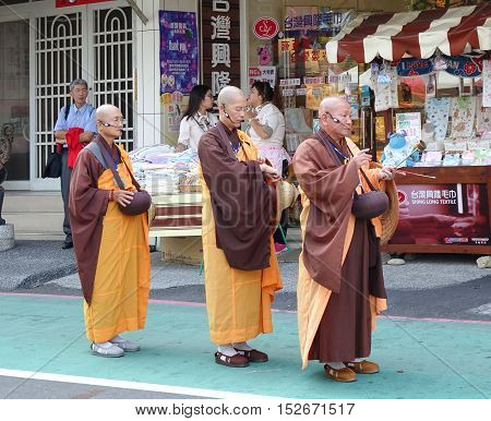 Three Buddhist Monks Chant Scriptures