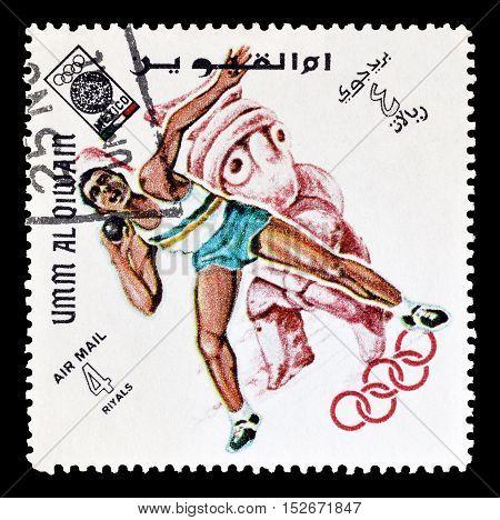 UMM AL QAIWAIN - CIRCA 1968 : Cancelled postage stamp printed by Umm al Qaiwain , that shows Shot putting.