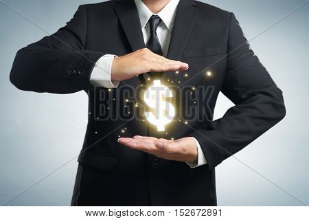 Businessman in suit with two hands in position to protect something (focus on hand blur out the suit). It indicates many aspects such as car insurance coverage support assurance reliability.