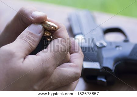 Loading Handgun Magazine. Bullets And Pistol Background. Charging Gun.