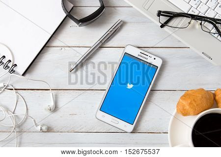 WROCLAW POLAND - OCTOBER 14th 2016: Samsung A5 with Twitter application laying on desk. Twitter is an online social networking service that enables users to send and read short 140-character messages called