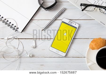 WROCLAW POLAND - OCTOBER 14th 2016: Samsung A5 with Snapchat application laying on desk. Snapchat is an image messaging and multimedia mobile application created by Evan Spiegel Bobby Murphy and Reggie Brown