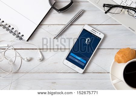 WROCLAW POLAND - OCTOBER 14th 2016: Samsung A5 with Tumblr application laying on desk. Tumblr is the service allows users to post multimedia and other content to a short-form blog.
