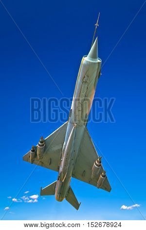 Fighter jet airplane flight under view clear blue sky background