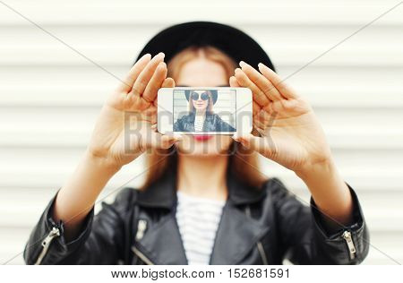 Fashion Cool Girl Taking Picture Self Portrait On Smartphone Over White Background