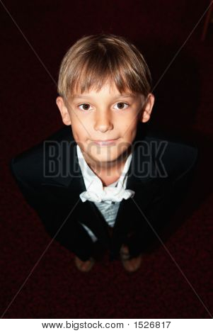 Young Boy Dressed To Serve