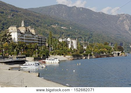 LAGO MAGGIORE ITALY - SEPTEMBER 25: Small luxury tourist town STRESA with its hotels and promenade at Lago Maggiore Italy on September 25 2016