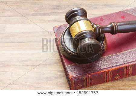 Wooden Law Gavel on legal book on wooden desktop