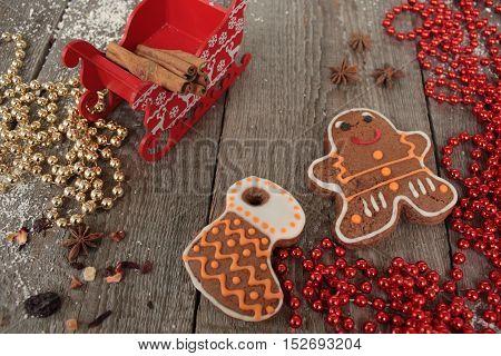Christmas gingerbread cinnamon, Christmas decorations, tea, beads, Santa's sleigh. beautiful festive dessert.