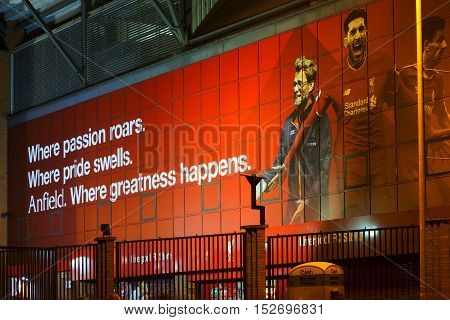 LIVERPOOL UK 17th OCTOBER 2016. Liverpool Football Club's new giant mural for the 2016/17 season at the Kop end of the stadium lit up at night