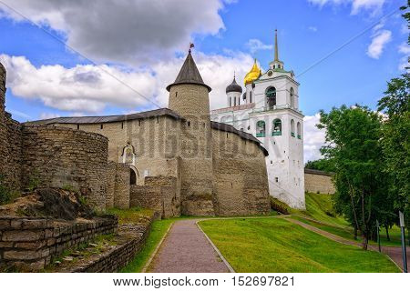 The Pskov Kremlin with surrounding walls and Trinity Church Pskov Russia. poster