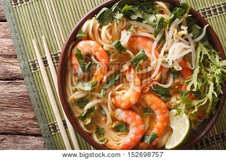 Laksa Soup With Shrimps, Noodles, Sprouts And Coriander In A Bowl Close-up. Horizontal Top View