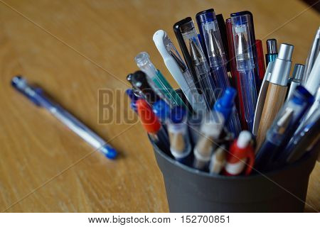 Writing utensils in the business environment with ball pens, highlighters and pens