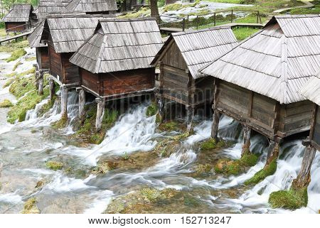 Wooden huts housing the traditional watermills at Pliva Lake in Jajce Bosnia