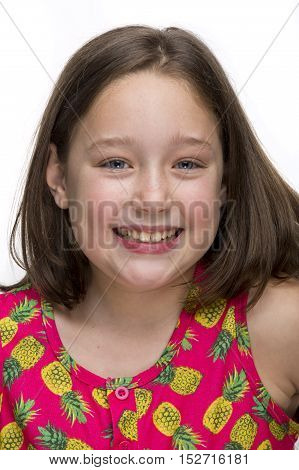 Pretty tween girl smiling at camera on a white background.
