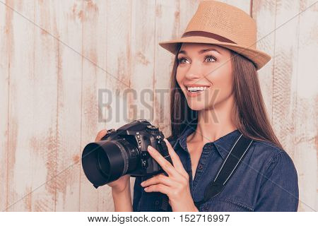 Young Happy Journalist  With Camera Making Photos In Studio