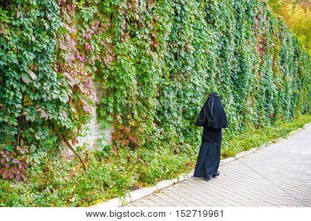 Christian Orthodox Nun Walking On Street