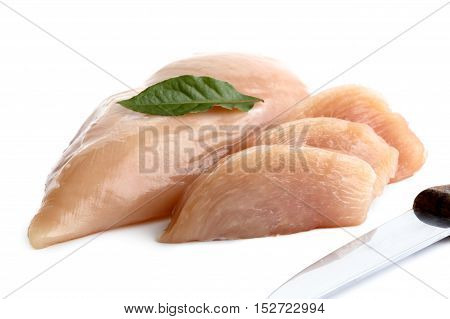 Whole Skinned Deboned Raw Chicken Breast Isolated On White Next To Chicken Breast Slices With Bay Le
