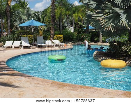 Reunion FL - September 25: several tourists enjoying time in a lazy river at a water park in Florida