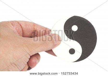 Hand Holding Yin-Yang Symbol isolated on white