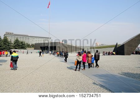 January 3 2015. Nanjing China. Chinese visitors walking into the Nanjing Massacre site and museum in Nanjing China located in Jiangsu Province.