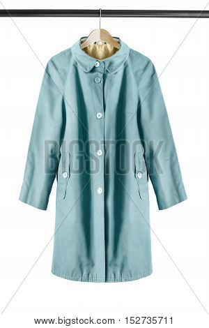 Blue raincoat on wooden clothes rack isolated over white