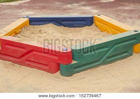 Children's sandbox childhood park with yellow sand