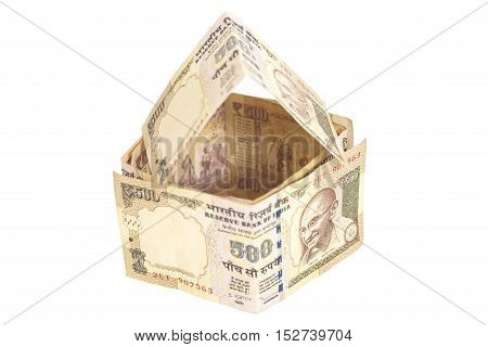House Made of Indian 500 rupee banknotes isolated on white