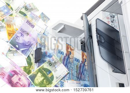 Printer printing  Swiss francs currency of switzerland isolated on white background