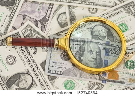 dollar US banknotes money under magnifying glass
