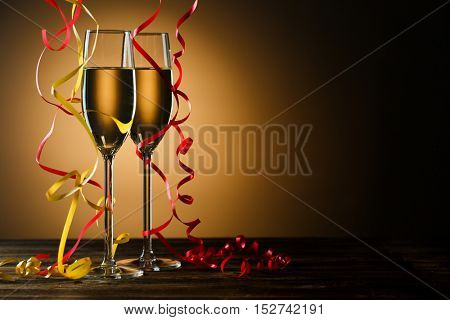 Two glasses with champagne on festive table
