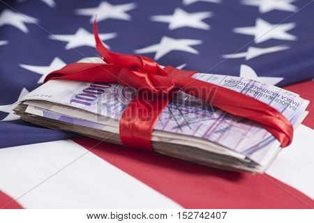 Swiss francs currency of switzerland With Red Bow on American flag background