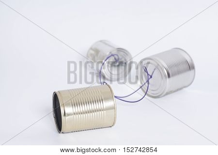Tin can phone on white .Telecommunication concept