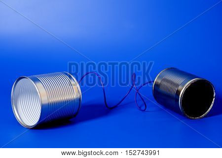 tin can phone  on blue background .communication concept