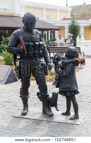 Monument to the Polite people. Simferopol, Crimea. Girl gives flowers to soldiers