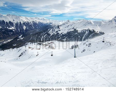 Ski slopes with chairlifts in the Golm ski resort with Montafon valley in the background, Voralberg, Austria