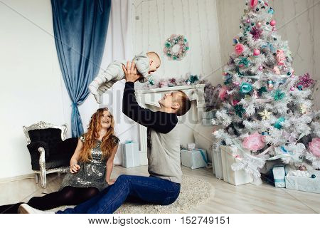 Christmas tree and happy family around at home