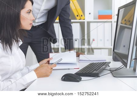 Concentrated Woman And Her Colleague