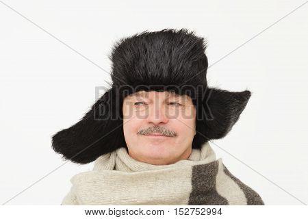 elderly man in warm fur hat with earflaps.